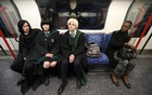 Cosplay fans (L-R) George Massingham, Abbey Forbes and Karolina Goralik travel by tube dressed in Harry Potter themed costumes, after a visit to one the literary franchise's movie filming locations at Leadenhall Market in London, Britain, Mar 10, 2017. Reuters