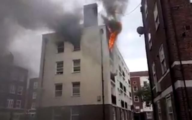 UK Firefighters Battle Blaze At Low-Rise Building In East London