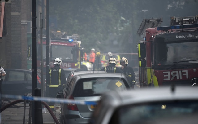 Firefighters battle blaze at low-rise building in east London