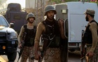 Pakistani soldiers return to the staging area after participating in a security operation on the outskirts of Peshawar on Saturday.