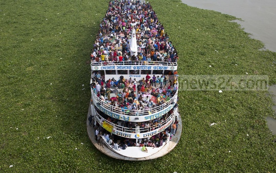 This overcrowded launch carrying hundreds of home-bound Eid holidaymakers inside and on the roof left Dhaka ​on Sunday morning. The picture was taken from the Bangladesh-China Friendship Bridge at the capital's Postogola. Photo: mostafigur rahman