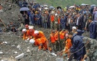 People search for survivors at the site of a landslide in Xinmo Village, Mao County, Sichuan province, China Jun 24, 2017. China Daily via Reuters