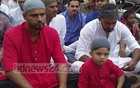 Bangladesh cricket captain, Mashrafe Bin Mortaza, attends Eid prayers in Narail's municipality Eidgah with son Sahel on Monday morning.
