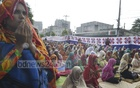 Women in Rajshahi participate in Eid prayers on Monday.