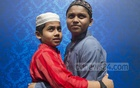Two boys embrace each other after the Eid prayers at Chittagong's Jamiatul Falah grounds on Monday. Photo: mostafigur rahman