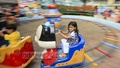 A child is all smiles as she takes a ride at DNCC Wonderland in Dhaka's Shyamoli a day after the Eid on Tuesday. Photo: asaduzzaman pramanik