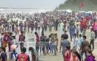 Tourists throng Cox's Bazar sea beach on Tuesday after the Eid.