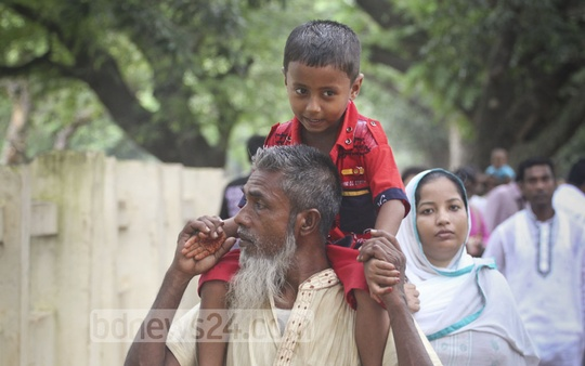 A young boy rides on the shoulders of his grandfather at the Mirpur zoo on Tuesday. Photo: asif mahmud ove
