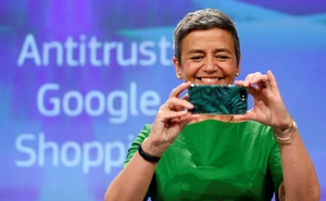 European Competition Commissioner Margrethe Vestager takes a photograph as she holds a news conference at the EU Commission's headquarters in Brussels, Belgium, on Jun 27.