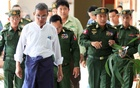 FILE PHOTO: Rakhine Chief Minister Nyi Pu (L) and Myanmar's high ranking military officers walk after a day trip with a diplomatic mission and United Nations officials to the Maungdaw areas in northern Rakhine State in Myanmar Nov 3, 2016. Reuters