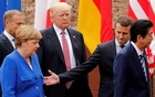 From L-R, European Council President Donald Tusk, German Chancellor Angela Merkel, US President Donald Trump, French President Emmanuel Macron and Japanese Prime Minister Shinzo Abe walk after a family photo during the G7 Summit in Taormina, Sicily, Italy, May 26, 2017. Reuters