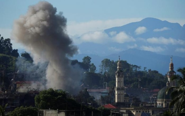 An explosion is seen after Philippines army airstrike as government troops continue their assault against insurgents from the Maute group in Marawi City, Philippines Jun 28, 2017. Reuters