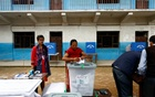 A woman, centre, casts her vote during the first phase of municipal polls in Thimi, Nepal May 14, 2017. Reuters