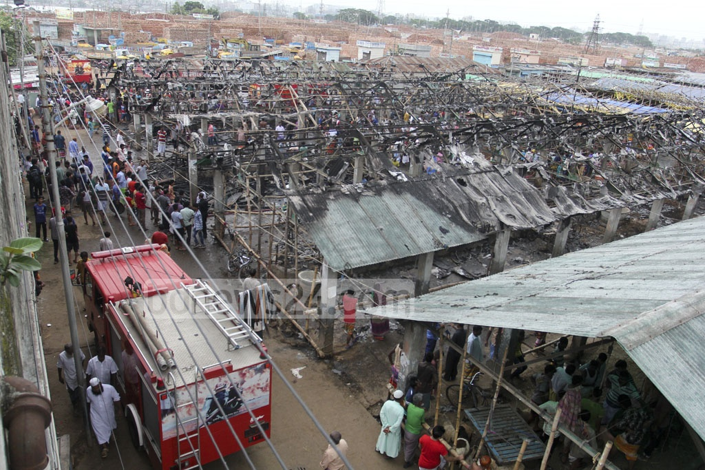 A fire gutted several sheds at Dhaka's Gabtoli livestock market on Thursday, killing several cows and goats. Photo: asif mahmud ove