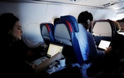 FILE PHOTO -- Passengers use their laptops on a flight out of John F Kennedy (JFK) International Airport in New York, US, May 26, 2017. Picture taken May 26, 2017. REUTERS/Lucas Jackson/File Photo
