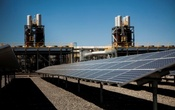 Solar panels are seen in front of a natural gas power plant at the Tahoe-Reno Industrial Center in McCarran, Nevada, US on Sep 16, 2014. Reuters