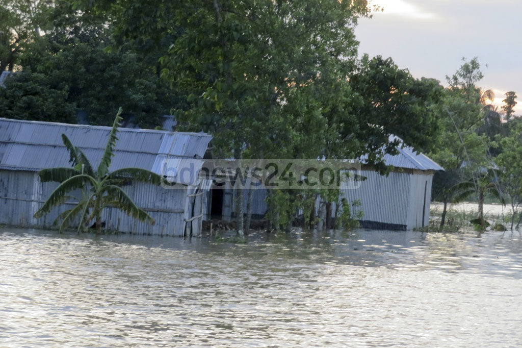 Over 100 villages in Moulvibazar remained waterlogged for about a month now. The inundation is caused by the heavy rains and water flows from upstream Indian regions. The photo was taken at a village in the northeastern district's Juri Upazila on Friday.
