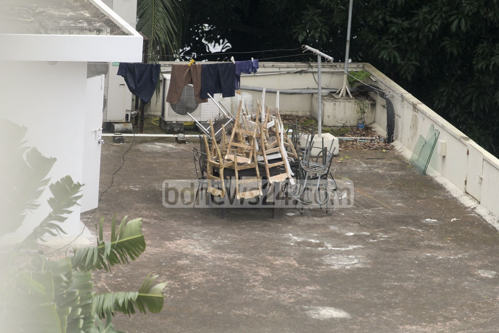 The furniture damaged in the terror attack and subsequent commando blitz in July last year has been dumped on the terrace of the two-storey building. Photo: asif mahmud ove