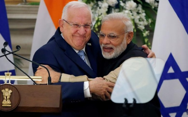 Rivlin and India's Prime Minister Narendra Modi hug each other after reading their joint statement at Hyderabad House in New Delhi India