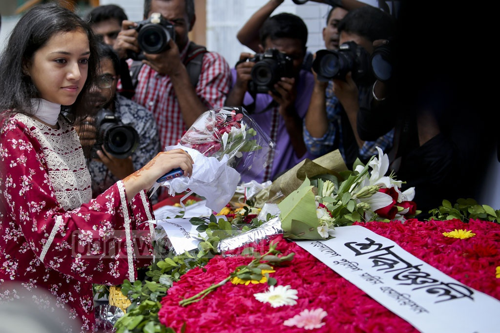 People from all walks of life came to Gulshan on Saturday to pay respect to the 22 people killed in the cafe attack a year ago. Photo: asaduzzaman pramanik