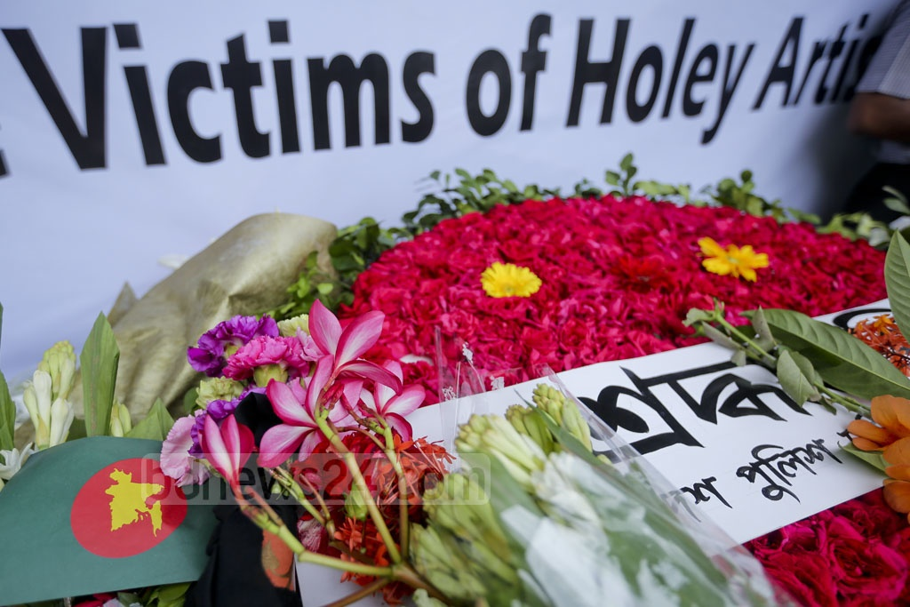Wreaths for the Holey Artisan victims are laid at the site of the attack in Gulshan on its first anniversary. Photo: asaduzzaman pramanik
