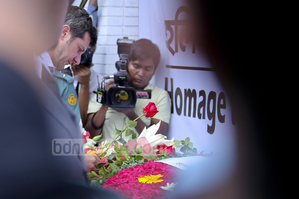 Some foreign nationals came to pay respect to the victims on Saturday at the site that used to house Holey Artisan Bakery and O' Kitchen restaurant, where 22 people, including 17 foreigners, were killed in a terrorist attack a year ago. Photo: asaduzzaman pramanik