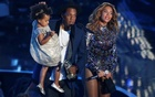 File Photo: Jay-Z presents the Video Vanguard Award to his wife Beyonce as he holds their daughter Blue Ivy during the 2014 MTV Video Music Awards in Inglewood, California, August 24, 2014. Reuters