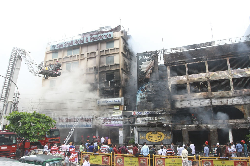 The fire started around 5:30am on the second floor of the four-storey building that housed the Sea Shell Restaurant. The fire left the restaurant completely damaged and spread to two buildings next to it soon after. Photo: tanvir ahammed