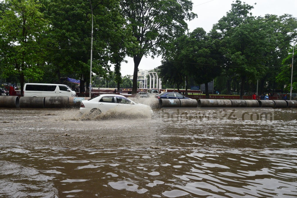 Rainwater floods the road in front of the Central Shaheed Minar in Dhaka following a downpour on Monday morning. Photo: asif mahmud ove