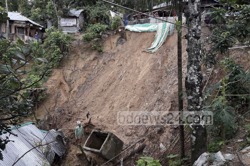 A landslide on Tuesday left these houses damaged in Khagrachhari. Incessant rains since Sunday morning resulted in the catastrophe in the hill town.