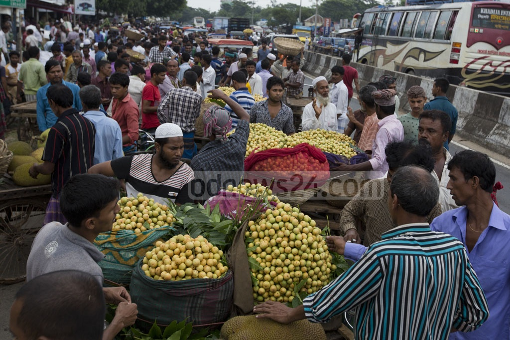 Traders and customers busy during sale at Marjal Lotkon market. Photo: mostafigur rahman