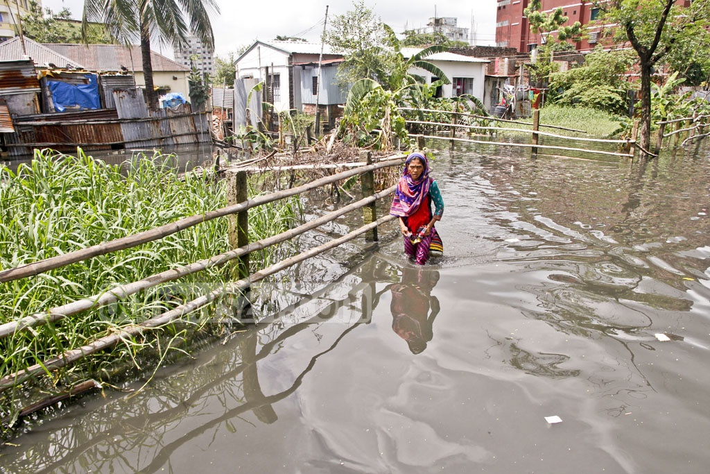 Residents of Islambagh in Narayanganj have been surrounded in water for nearly months, well before the rainy season began. Photo: tanvir ahammed
