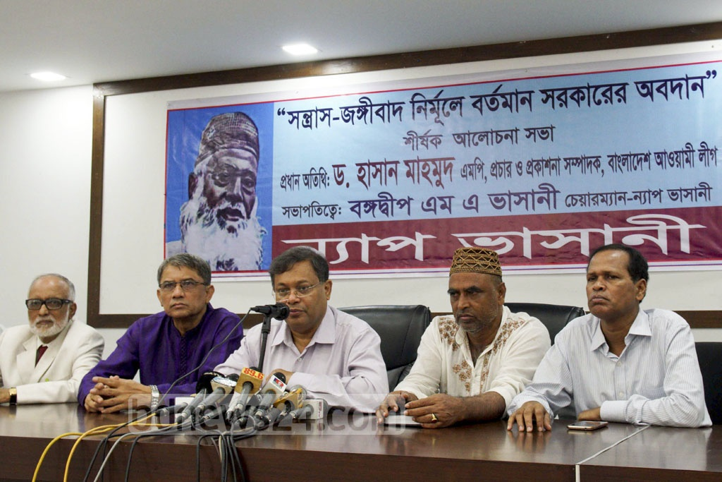 Awami League Publication Secretary Hasan Mahmud attends a discussion on the government's role in eradicating terror and militancy at the National Press Club on Thursday.