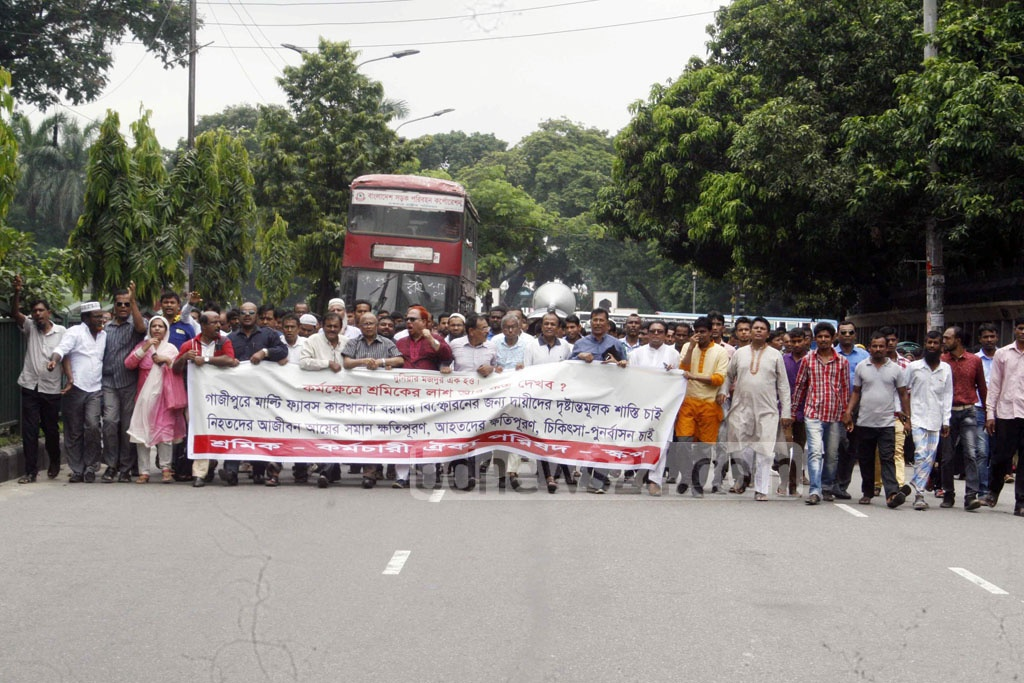 Sramik Karmachari Oikya Parishad, a unity for worker rights, takes out a procession near Dhaka's National Press Club to demand punishment for owners of Gazipur-based Multifabs. A recent boiler blast in the apparel factory has killed 13 workers.