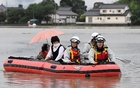 Local residents are rescued by firefighters after heavy rain hit the area in Asakura, Fukuoka Prefecture, Japan in this photo taken by Kyodo on Jul 6, 2017. Kyodo/via Reuters