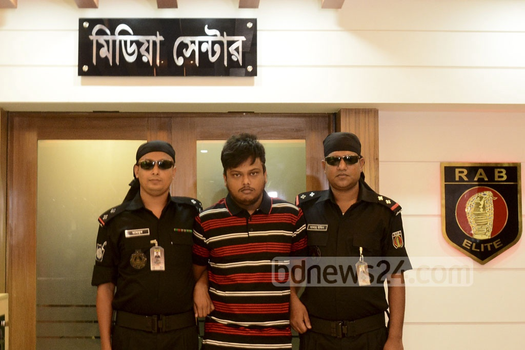 The Rapid Action Battalion put Bahauddin Evan on a media parade in Karwanbazar Media Centre on Friday after he was arrested on charges of raping a TV actress in Banani.