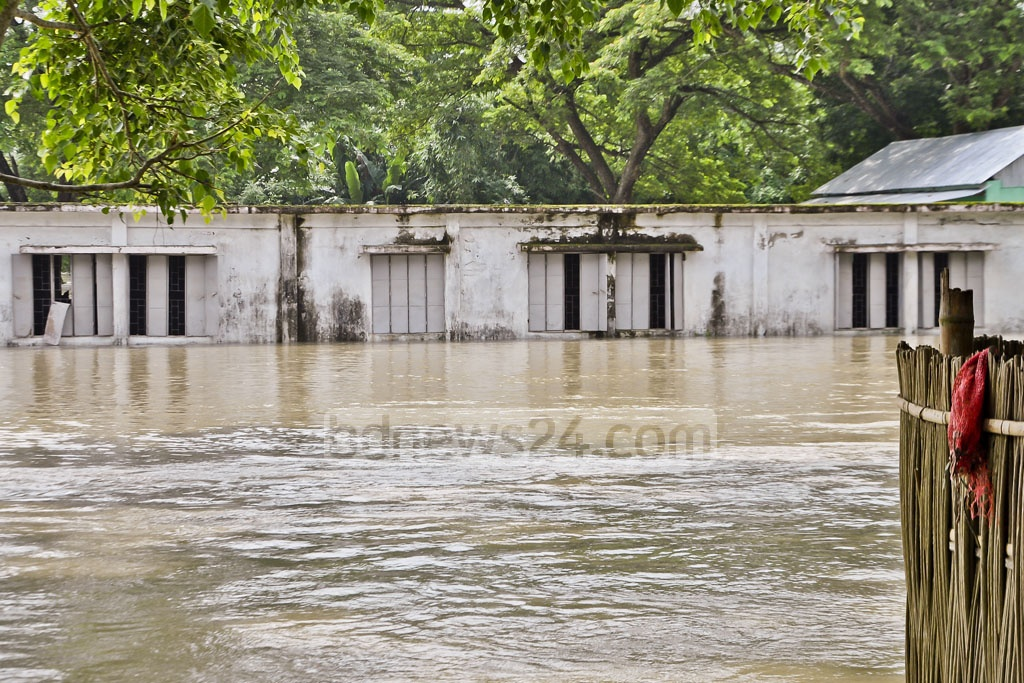 Houses on low-lying lands are inundated in Jamalpur as levels of river water have gone up following flashfloods, leaving thousands of residents marooned.
