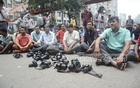 Journalist organisations block the street in front of the National Press Club on Saturday protesting the arrest of Daily Observer photojournalist Ashik Muhammad and demanding his release.