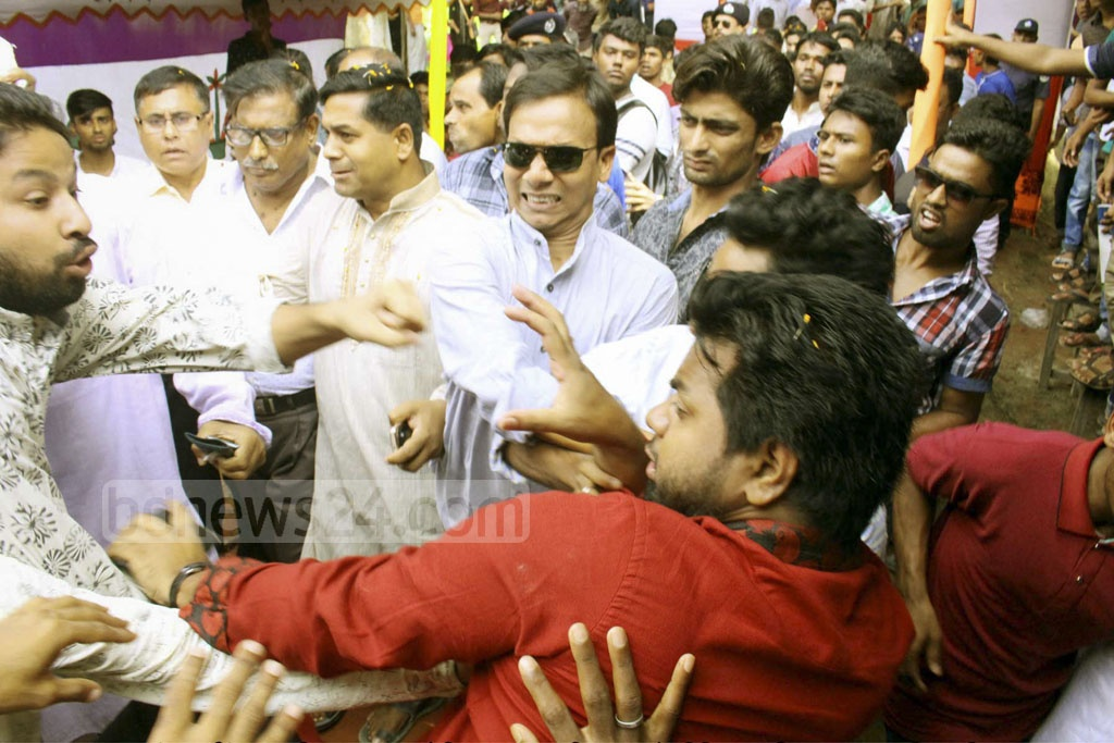 Two factions of Bangladesh Chhatra League scuffle during a freshers reception function at Rajapur Degree College in Jhalakathi on Sunday.