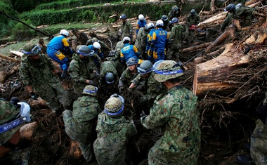 Japanese Self-Defense Force soldiers and police officers conduct search and rescue operation in Toho village, Fukuoka Prefecture, Japan Jul 8, 2017. Reuters