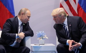 Russia's President Vladimir Putin talks to US President Donald Trump during their bilateral meeting at the G20 summit in Hamburg, Germany July 7, 2017. Reuters