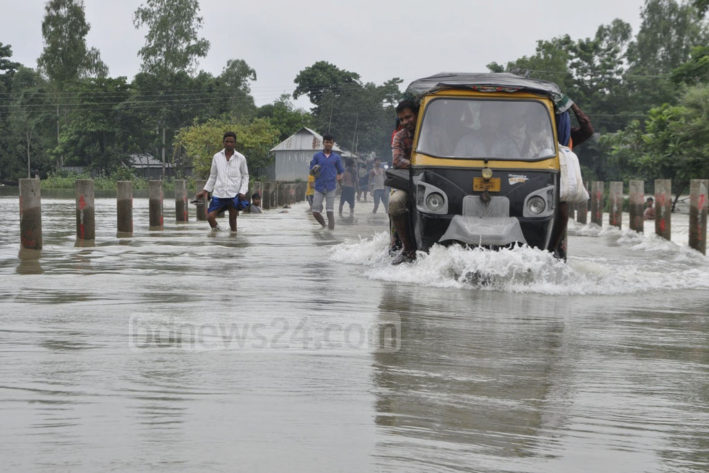 The Melandaha-Mahmudpur road in Jamalpur on Monday. Many parts of the area have gone under knee to waist-deep flood water.