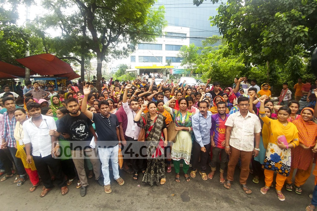 Q-Point Fashions Ltd workers demonstrate in front of the BGMEA building to demand back pay after their factory was relocated from Dhaka's Mirpur.