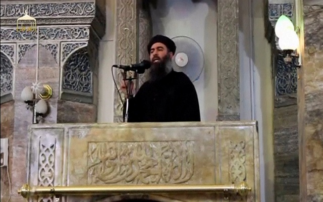 A man purported to be the reclusive leader of the militant Islamic State Abu Bakr al-Baghdadi making what would have been his first public appearance, at a mosque in the centre of Iraq's second city, Mosul, according to a video recording posted on the Internet on July 5, 2014, in this still image taken from video. Reuters