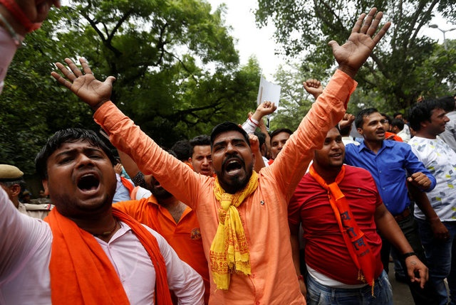 Activists of Hindu nationalist group Vishva Hindu Parishad (VHP) shout slogans during a protest against the killing of seven Hindu pilgrims in a gunbattle that erupted in Kashmir on Monday, in New Delhi, India, July 12, 2017. Reuters