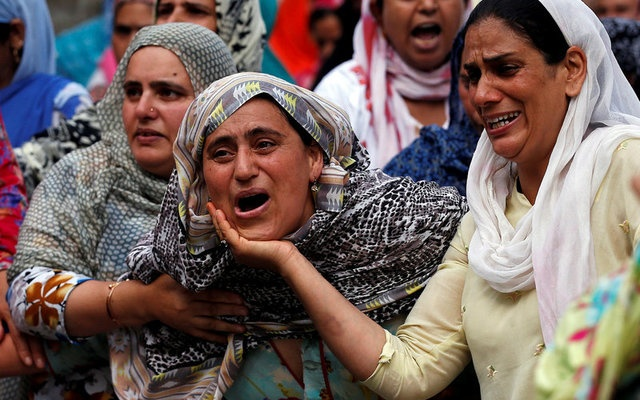 Relatives mourn during the funeral of Aaquib Gul, who according to local media, was killed in a gun battle with Indian security forces at the Radbugh Village of Budgam District, in Srinagar July 12, 2017. Reuters