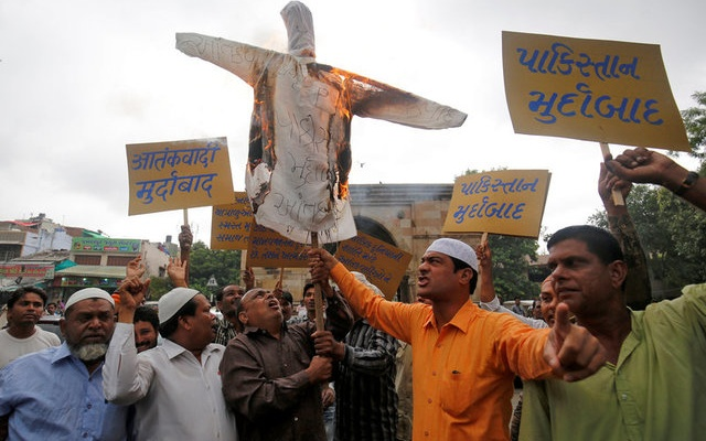 Demonstrators shout slogans and burn an effigy during a protest against the killing of seven Hindu pilgrims in a gunbattle that erupted in Kashmir on Monday, in Ahmedabad, India, July 11, 2017. The writing on an effigy reads: 'Down with terrorism, down with Pakistan'. Reuters