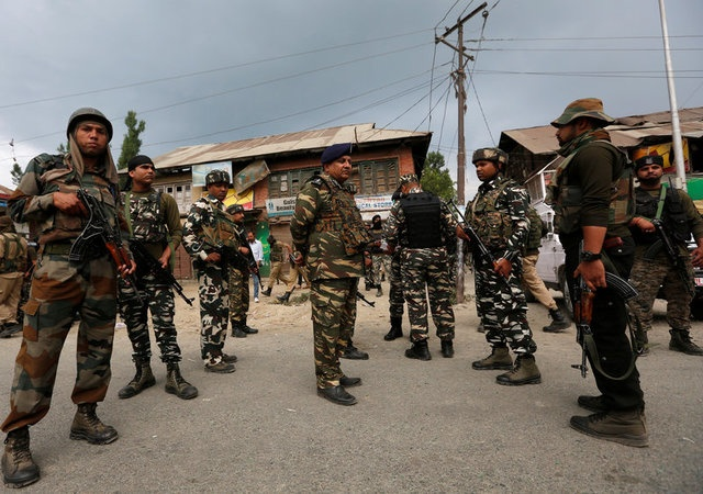 Indian security force personnel stand at the site of a gunbattle between Indian police and militants on Monday in which seven Hindu pilgrims were killed, in Boateng village in south Kashmir's Anantnag district July 11, 2017. Reuters
