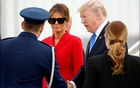 Trump, escaping domestic troubles, visits France's Macron