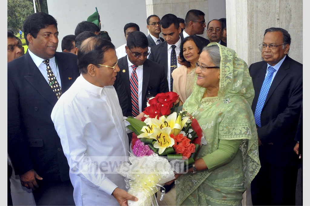 Prime Minister Sheikh Hasina greets Sri Lankan President Maithripala Sirisena at her office on Friday morning. The Sri Lankan leader is in Bangladesh on a three-day state visit. Photo: PID
